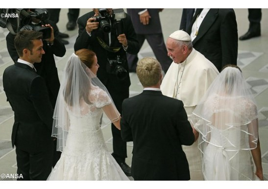 Pope Francis greets newly married couples during his General Audience in the Paul VI Hall - ANSA