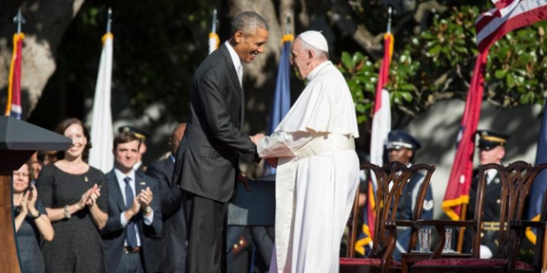 U.S. President Barack Obama greets Pope Francis during an arrival ceremony on the South Lawn of the White House in Washingont on September 23, 2015. (CNS photo/Joshua Roberts) See POPE-WHITE-HOUSE Sept. 23, 2015.