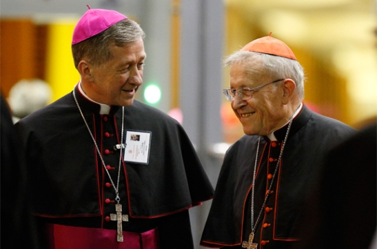 Archbishop Blase J. Cupich of Chicago talks with German Cardinal Walter Kasper