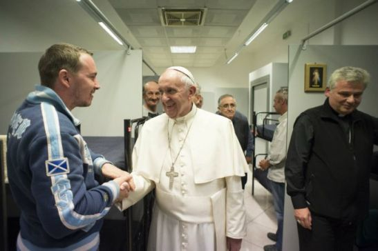 Pope Francis makes a visit to Rome's new dorms for homeless men on Oct. 15, 2015.