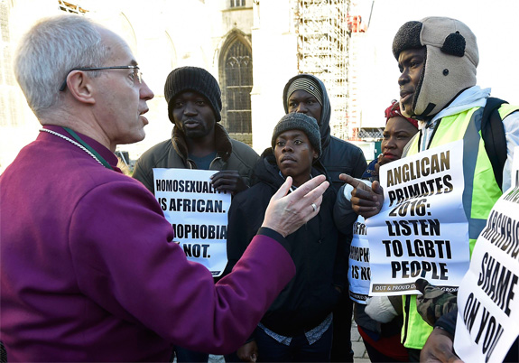 The archbishop of Canterbury with protesters in the grounds of Canterbury Cathedral earlier this month.