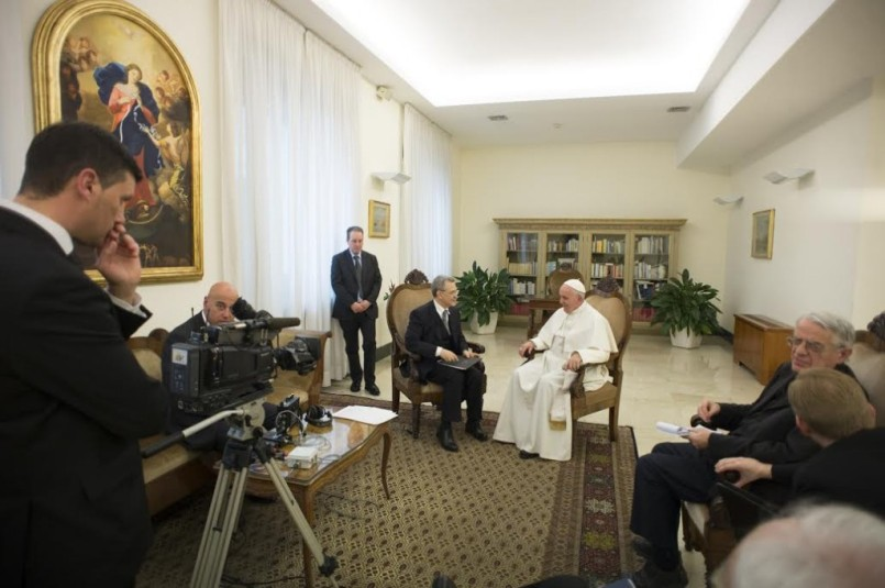 Francesco Sisci (left) interviews Pope Francis at the Vatican with papal staffers