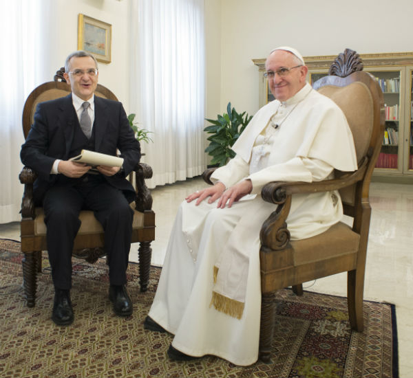Francesco Sisci sitting with Pope Francis