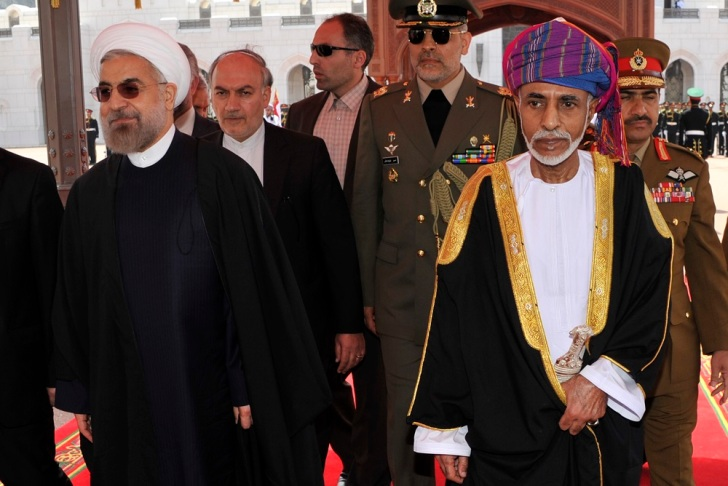 Oman's Sultan Qaboos bin Said walks with Iran's President Hassan Rouhani upon Rouhani's arrival in Muscat