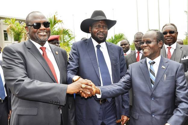 First Vice President of South Sudan Riek Machar, President Salva Kiir and Second Vice President of James Wani Igga after the formation of the new cabinet of the Transitional Government in Juba on April 29, 2016.