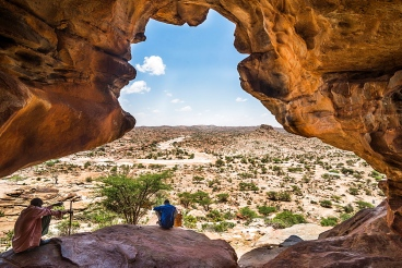 Local guide sitting in one the Laas Geel caves, Somaliland, Somalia, Africa